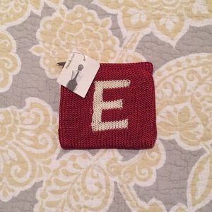 "The Sak initial ""E"" coin purse"